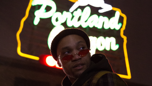Jordan Johnson, better known as Iamjordan, poses for a photo in front of iconic Portland, Oregon sign