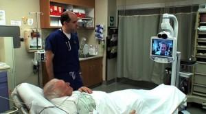 Dr. Clark consults via telemedicine console