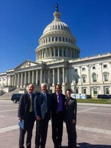 Peter Kalivas, PhD; Christopher Cowan, PhD; Douglas Munoz, PhD; and Mollie Marr (left to right) pause in front of the US Capitol building between meetings with congressmen as part of SfN's Capitol Hill Day.