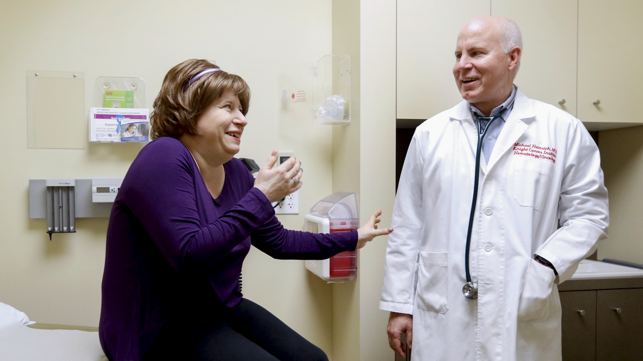 Michael Heinrich, M.D. meets with Victoria Castle of Sacramento, California during an appointment, November 1, 2017 at OHSU. Castle, who was diagnosed with gastrointestinal stromal tumor in 2009, began seeing Heinrich in 2014. (OHSU/Kristyna Wentz-Graff)