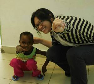 One of the fellows, Melinda Wu, poses with a patient in 2014