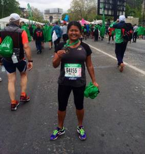 In her spare time, Dr. Guzman loves long-distance running. Here she is at the 2015 Paris International Marathon!