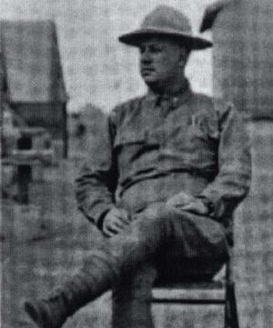 Marius Marcellus, seated, in uniform