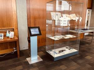 The new exhibit kiosk for Historical Collections & Archives, showing the title slide for Queering OHSU.