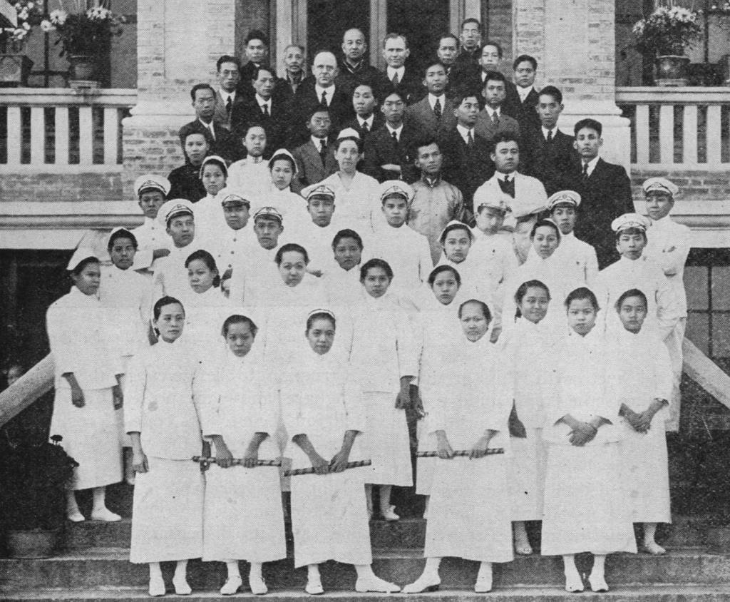 Staff of the Kung Yee Hospital in 1921, pictured on the steps of the building