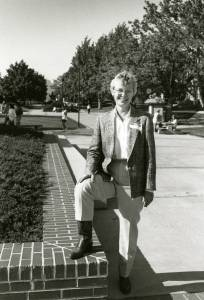 Dean Carol Lindeman outfitted in cowboy boots during a visit to LaGrande, 1989.