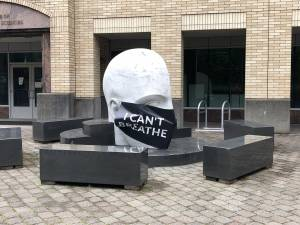 "Vitae Mensae, a sculpture by Larry Kirkland located on the OHSU Marquam Hill campus, wears an over-sized face mask with the words ""Black Lives Matter"" printed upon it."