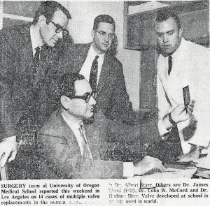 """Newspaper clipping including a black and white photograph of members of research team of Albert Starr, M.D. From left to right, James Wood, M.D., Albert Starr, M.D. (seated), Colin McCord, M.D., and Rodney Herr, M.D. The photograph is captioned, """"Surgery team at University of Oregon Medical School reported this weekend in Los Angeles on 14 cases of multiple valve replacements in human heart."""""""