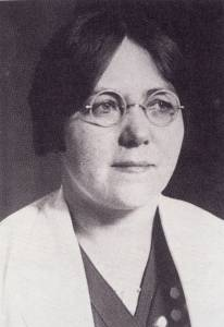 Black and white portrait; Mary Broadfoot Walker, in lab coat with wire-rimmed glasses..