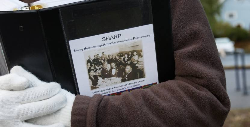 Photos and memory prompts engage participants in the Sharing History through Active Reminiscence and Photo-Imagery (SHARP) study.