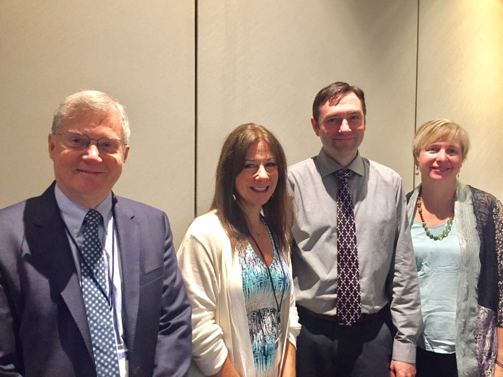From Left to Right: Center director, Kent Anger, Associate directors Leslie Hammer and Ryan Olson, and collaborator Diane Rohlman following their symposium on Total Worker Health ® Interventions.
