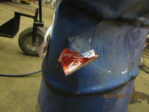 used metal drum with flammable label