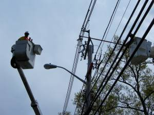 Worker tending to power lines