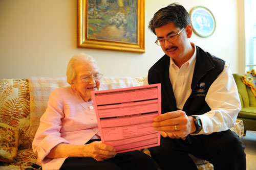 Erik Fromme, M.D., reviewing a POLST form with a patient