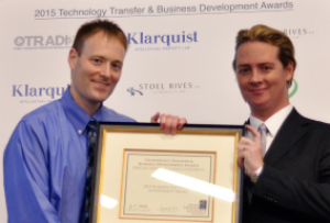 Jeffrey Tyner, Ph.D. accepting the TTBD Business Partnership Award with Brendan Rauw, M.B.A., C.L.P.