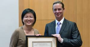 Yali Jia, Ph.D., accepts the New Inventor of the Year award from Brendan Rauw, M.B.A., CLP, vice president of Technology Transfer and Business Development